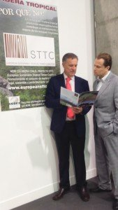 Alberto Romero discusses AEIM's STTC brochure with a stand visitor at Maderalia